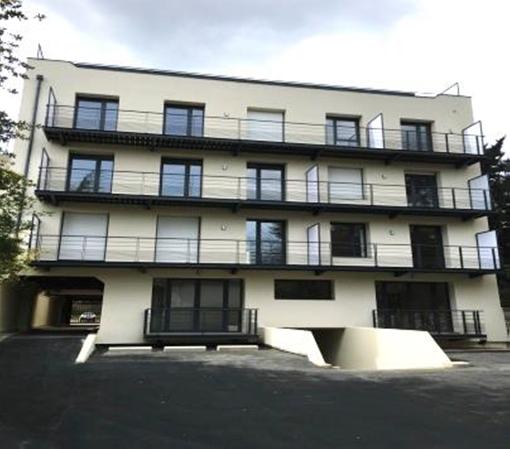 Surélévation et transformation de bureaux en logements_1